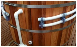 Install plumbing in a DIY Hot Tub